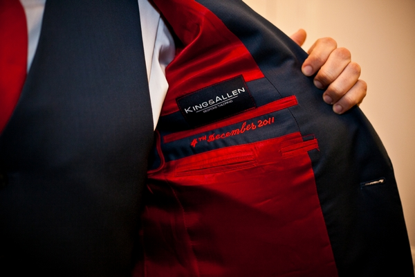 Red lining in wedding suit jacket - Picture by Anneli Marinovich Photography