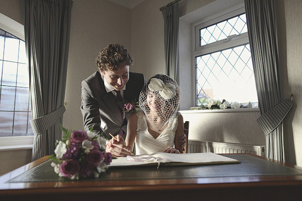 Bride and groom signing the register - Picture by York Place Studios