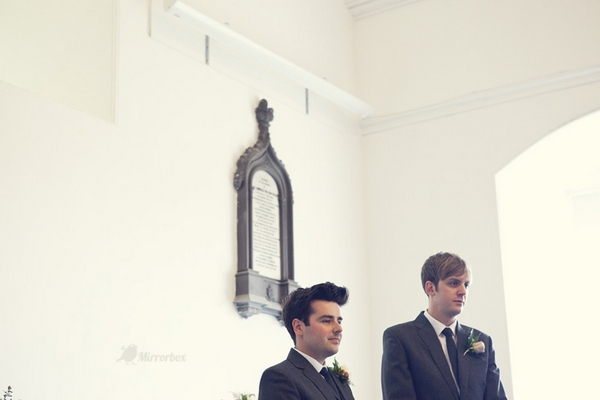 Groom and best man waiting in church - Picture by Mirrorbox Photography
