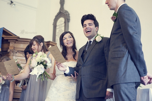 Bride and groom singing in wedding ceremony - Picture by Mirrorbox Photography