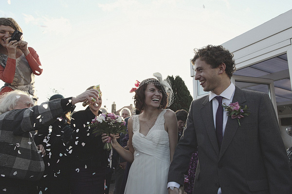 Bride and groom walking shrough confetti shower - Picture by York Place Studios