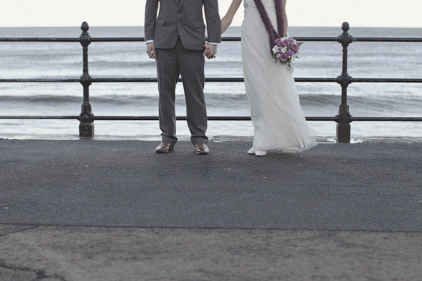 Bride and groom's legs by the sea - Picture by York Place Studios