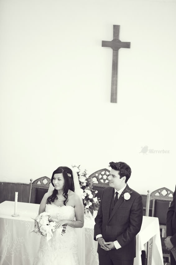 Bride and groom standing by altar - Picture by Mirrorbox Photography