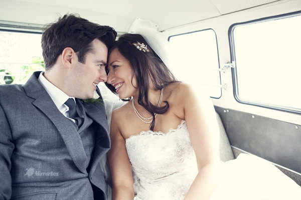Bride and groom in back of VW camper van - Picture by Mirrorbox Photography