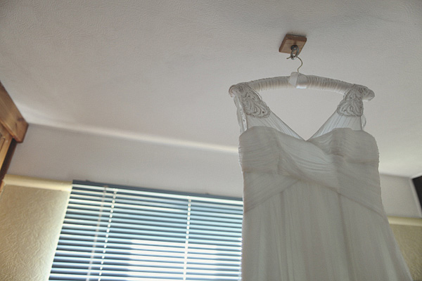 Wedding dress hanging from ceiling - Picture by York Place Studios