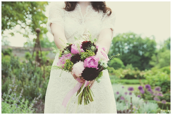Bride holding bouquet of purple flowers - Picture by Fiona Kelly Wedding Photography