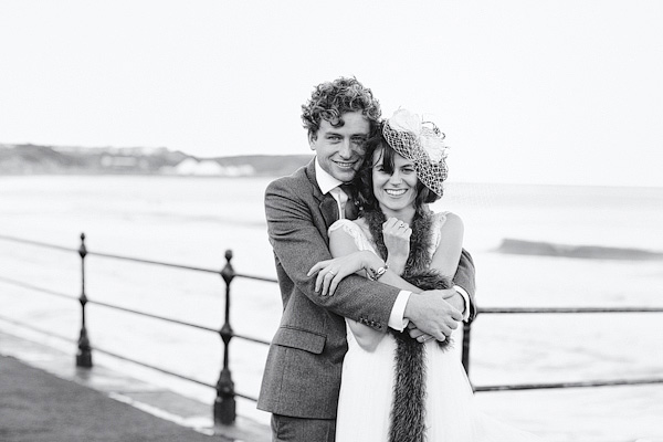 Black and white picture of groom with his arms around bride - Picture by York Place Studios
