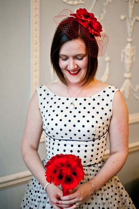 Bride with blue polka dot dress holding red bouquet - Picture by Anneli Marinovich Photography