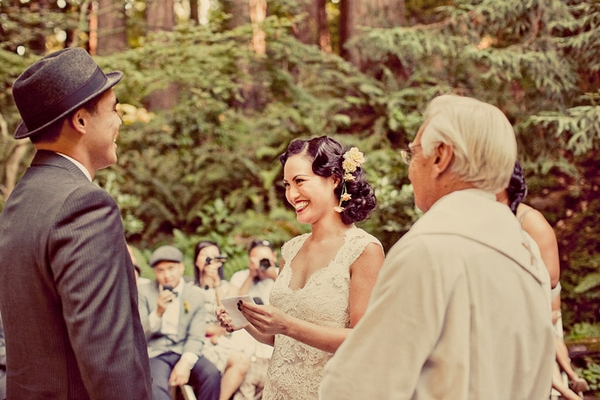 Bride laughing during vintage wedding ceremony - Picture by Paco and Betty