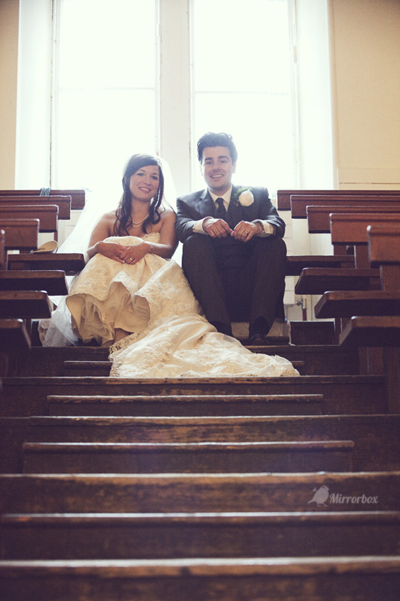 Bride and groom sitting in town hall - Picture by Mirrorbox Photography