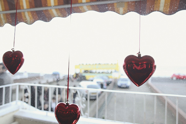 Red hearts hanging in window - Picture by York Place Studios
