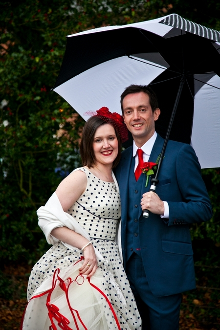 Bride and groom under umbrella - Picture by Anneli Marinovich Photography