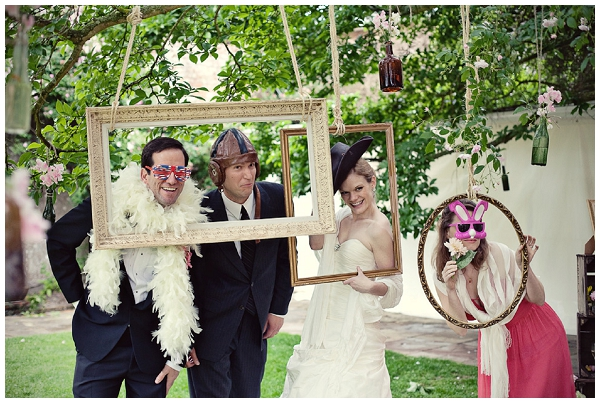 Wedding guests posing in picture frames - Picture by Marianne Taylor Photography