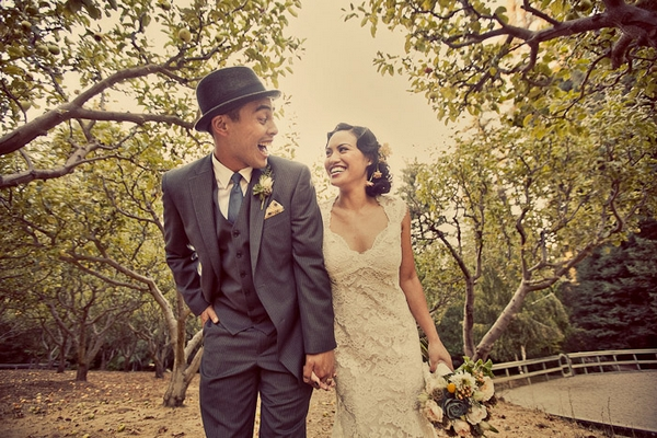 Vintage bride and groom holding hands and laughing - Picture by Paco and Betty