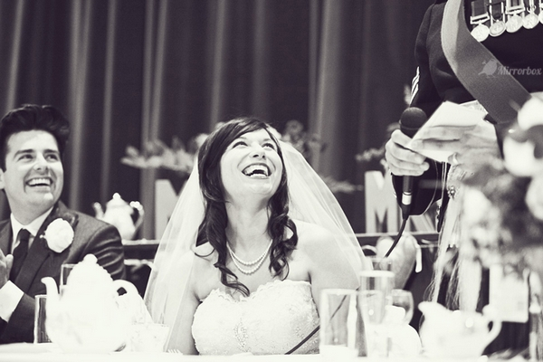 Bride laughing at wedding speech - Picture by Mirrorbox Photography