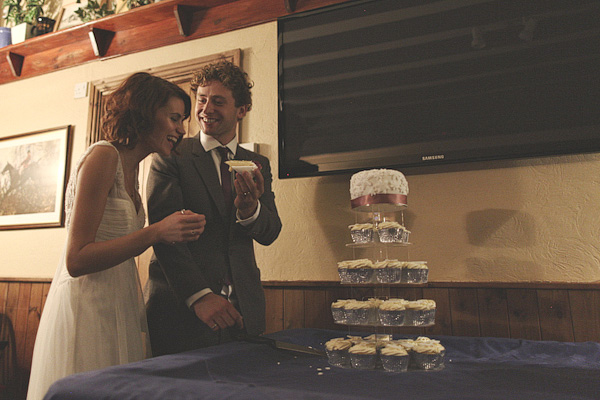 Bride and groom cutting wedding cake - Picture by York Place Studios