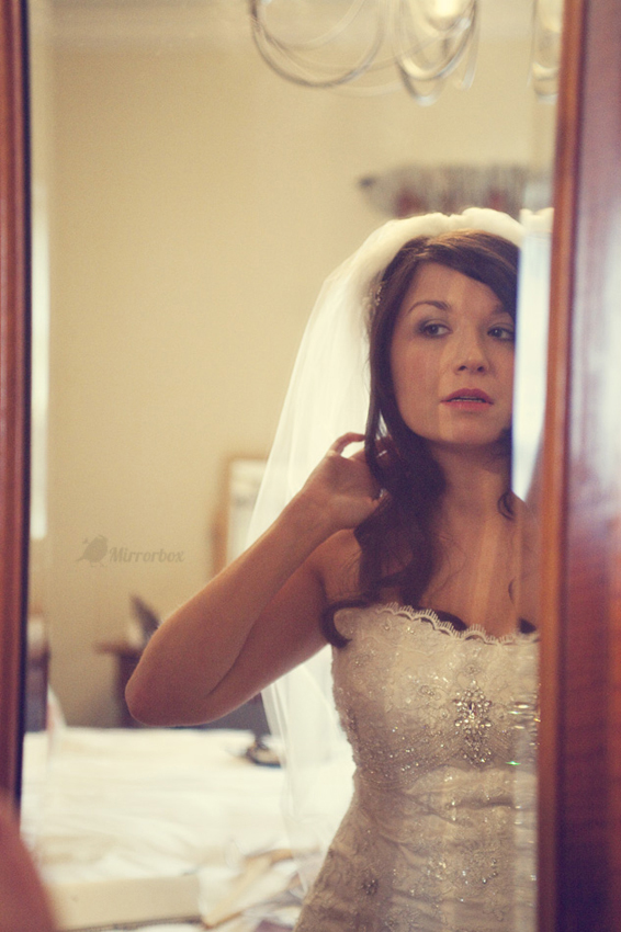 Bride looking in mirror - Picture by Mirrorbox Photography