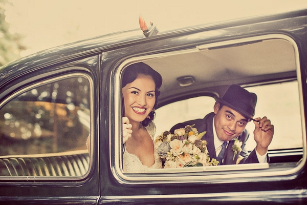 Vintage bride and groom in wedding car - Picture by Paco and Betty