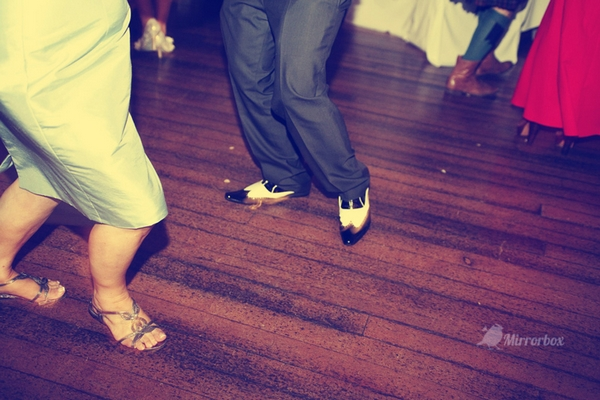 Legs of wedding guests dancing - Picture by Mirrorbox Photography