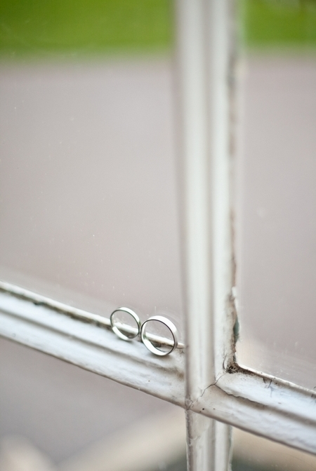 Wedding rings on window frame - Picture by Anneli Marinovich Photography