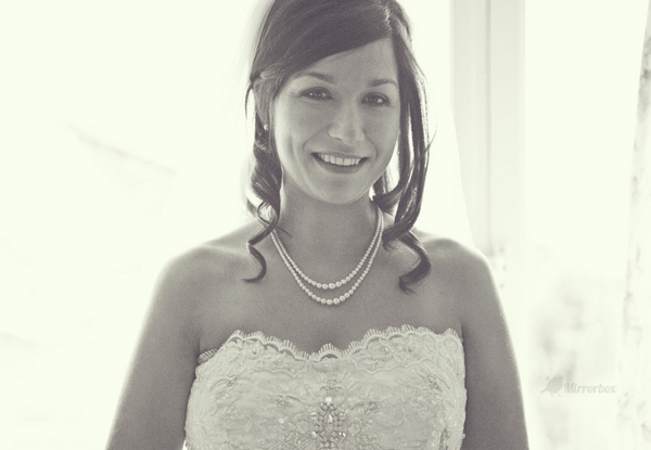 Bride smiling - Picture by Mirrorbox Photography
