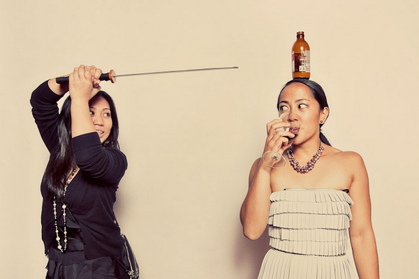 Wedding guests posing in funbooth with samurai sword - Picture by Paco and Betty