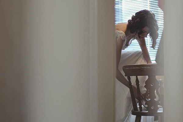 Bride putting on wedding shoe - Picture by York Place Studios