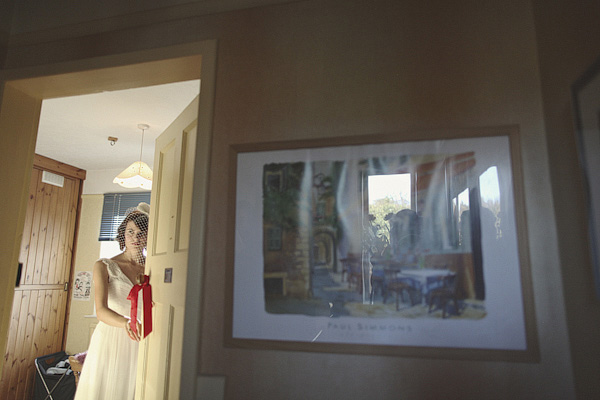 Picture of bride through door - Picture by York Place Studios