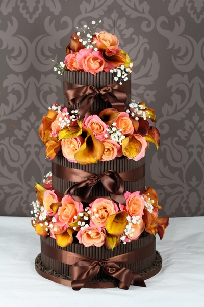 Dark Cigarello and Orange Cala Lilly Wedding Cake from Le Paillon Patisserie