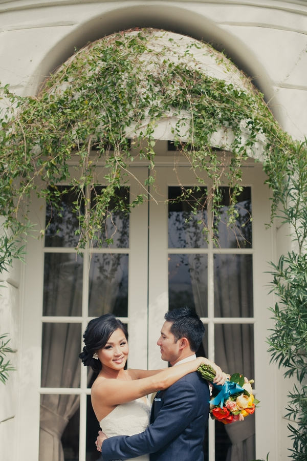 Bride and groom holding each other - Picture by onelove photography