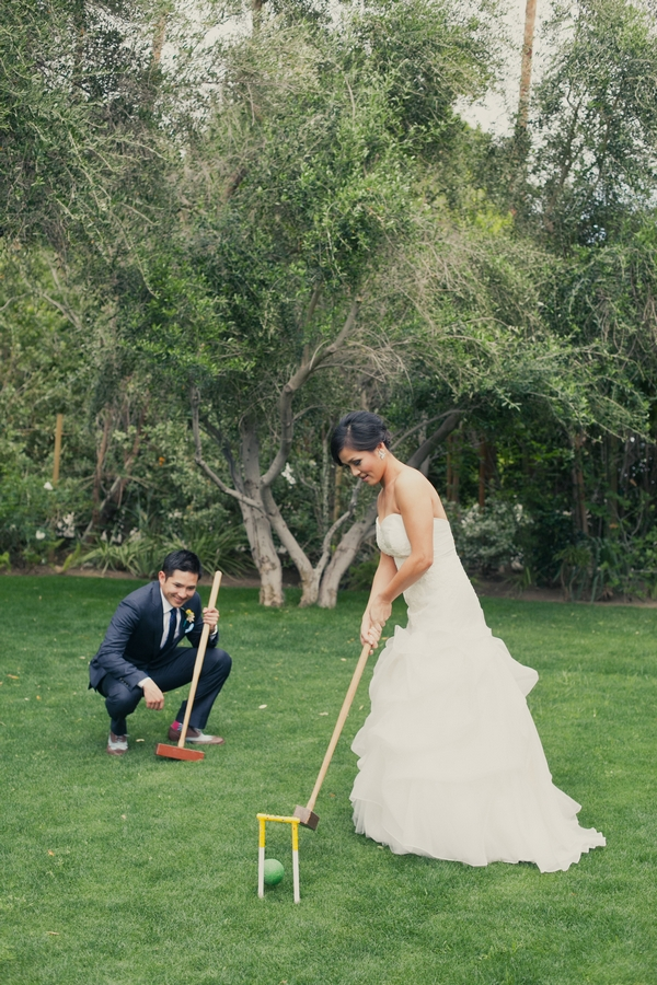 Bride and groom playing croquet - Picture by onelove photography