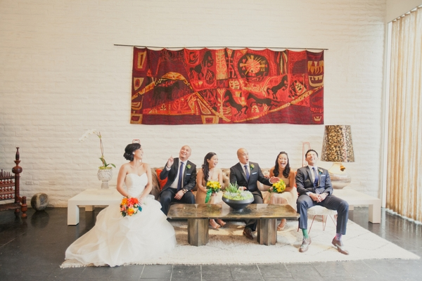 Bridal party sitting on sofa - Picture by onelove photography