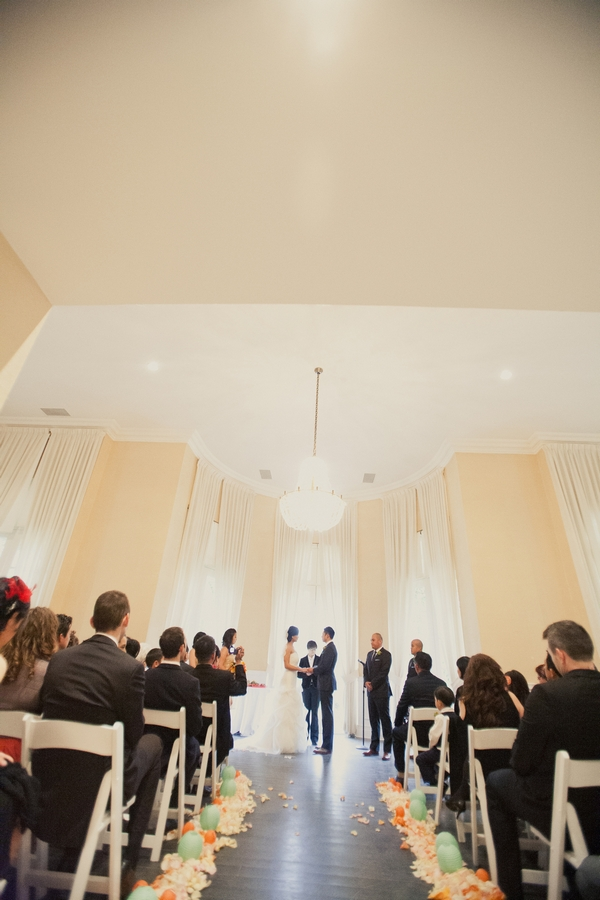 Looking down the aisle of wedding ceremony - Picture by onelove photography