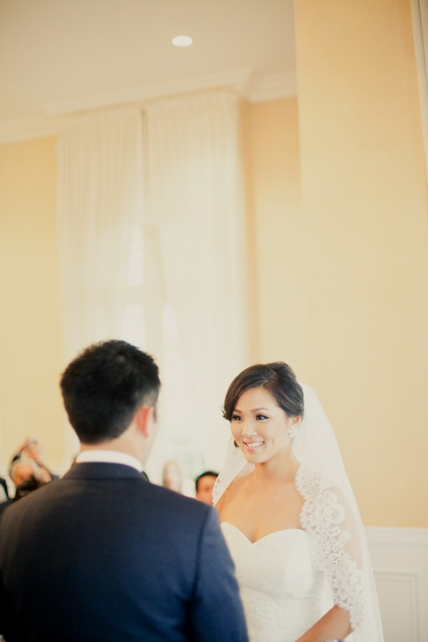 Bride looking at groom during wedding ceremony - Picture by onelove photography