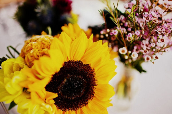 Sunflower wedding table flowers - Picture by Judy Pak Photography