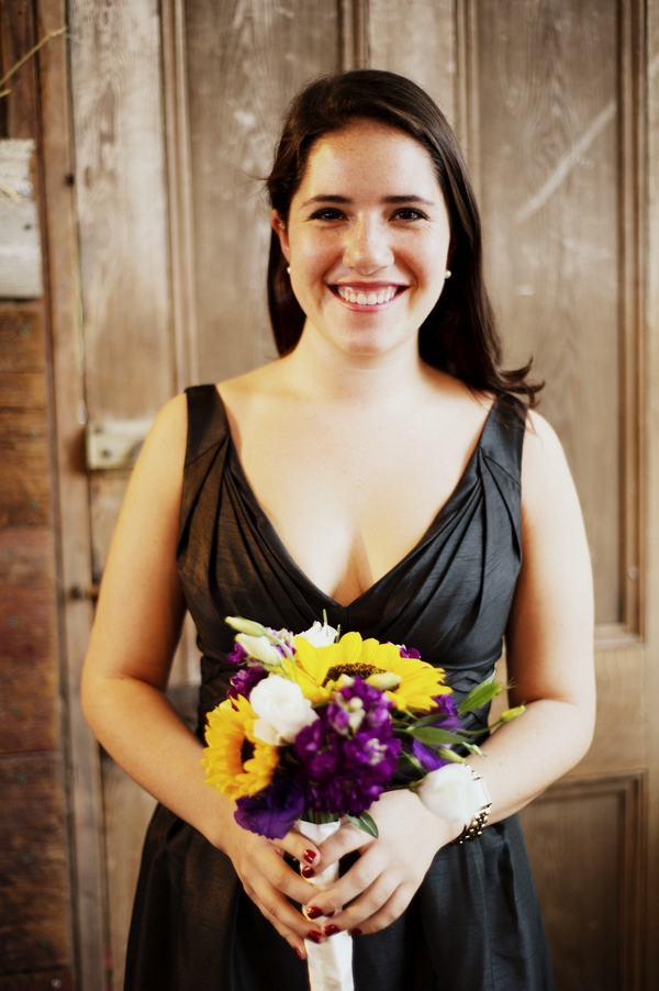 Bridesmaid in dark dress holding bouquet - Picture by Judy Pak Photography