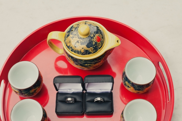 Wedding rings on tray with tea - Picture by onelove photography