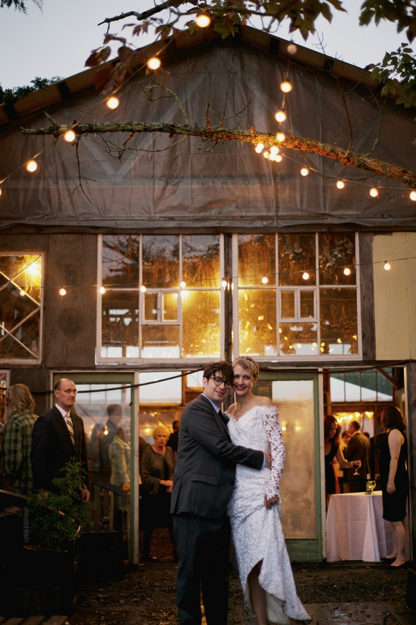 Bride and groom standing in the rain - Picture by Judy Pak Photography