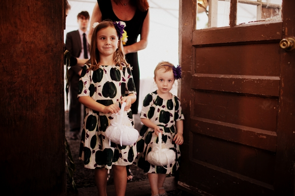 Flower girls leading bride into wedding - Picture by Judy Pak Photography