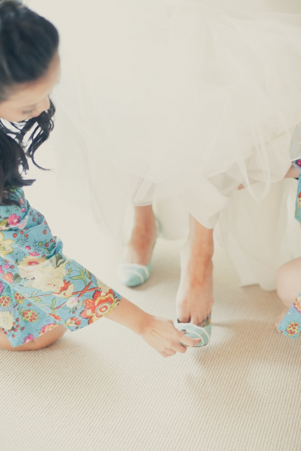 Bride putting on wedding shoes - Picture by onelove photography