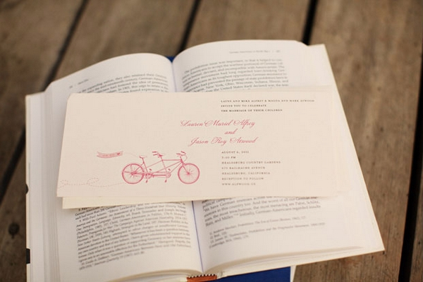 Wedding invitation on book - Picture by Kate Harrison Photography