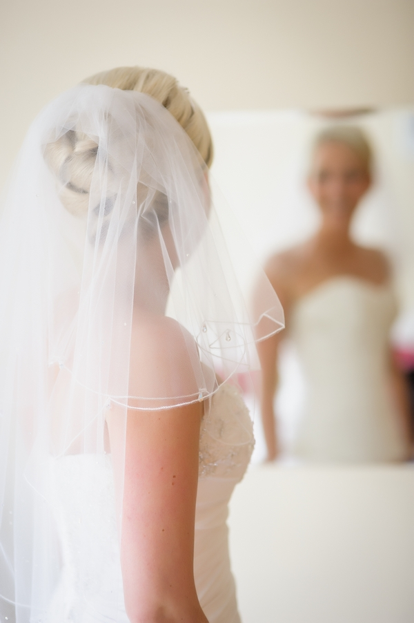 Bride looking at herself in the mirror - Picture by Pixies in the Cellar