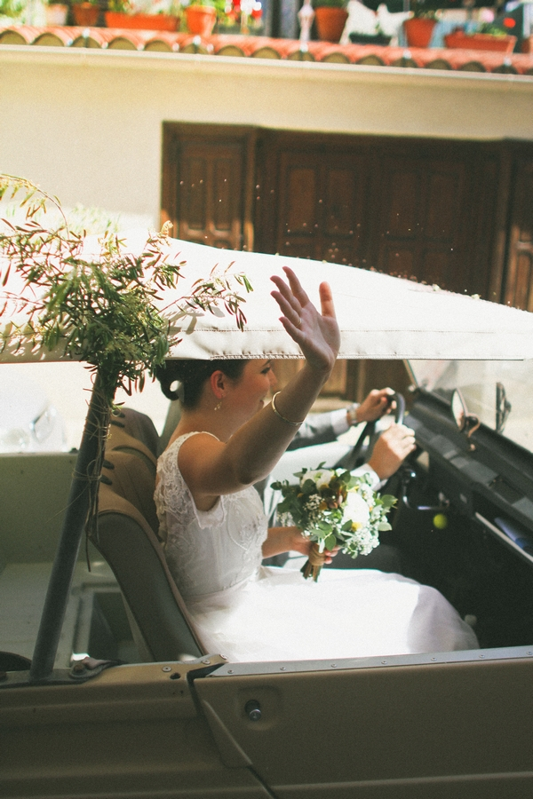 Bride waving out of window of wedding car - Picture by DanielRM