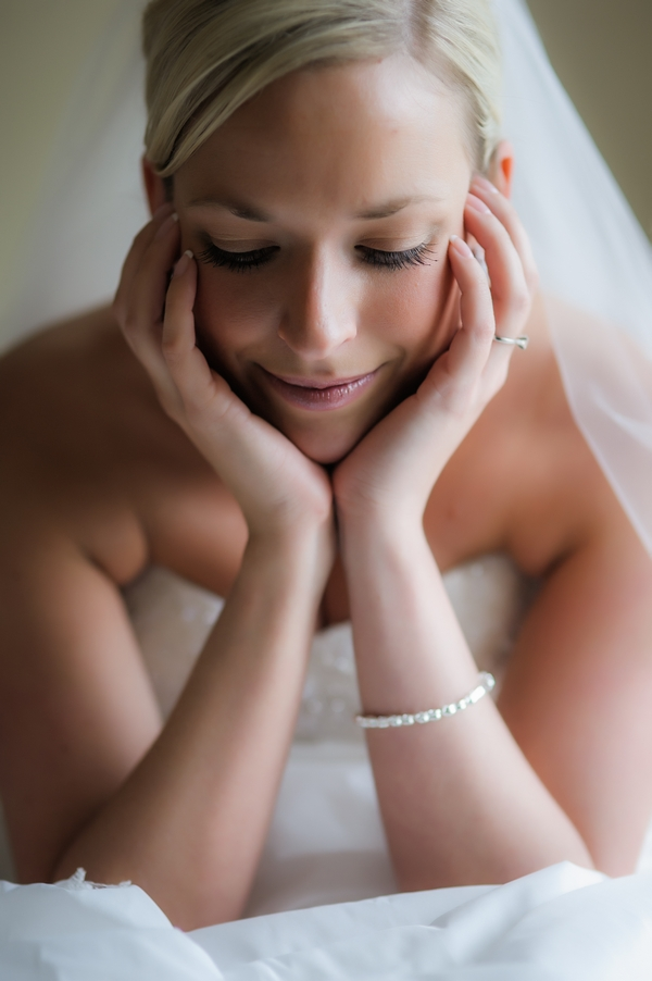 Bride resting her head in her hands - Picture by Pixies in the Cellar