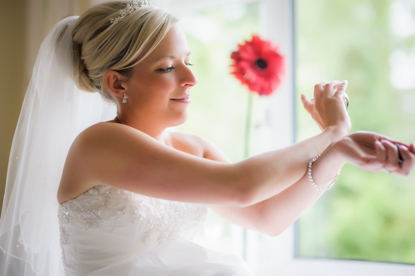 Bride rubbing pefume into her wrists - Picture by Pixies in the Cellar