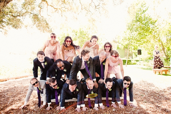 Bridal party in human pyramid - Picture by Kate Harrison Photography