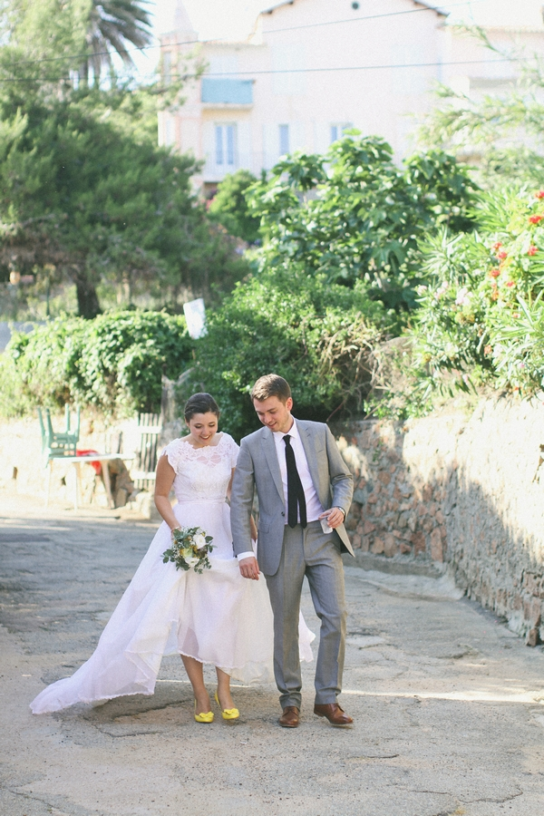 Bride and groom walking through streets of Cargese - Picture by DanielRM
