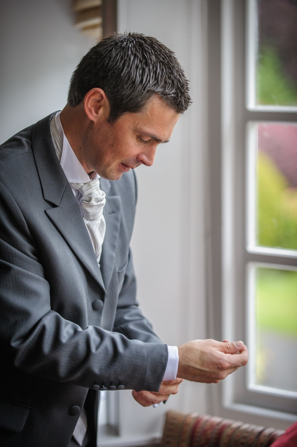 Groom doing up cufflink - Picture by Pixies in the Cellar