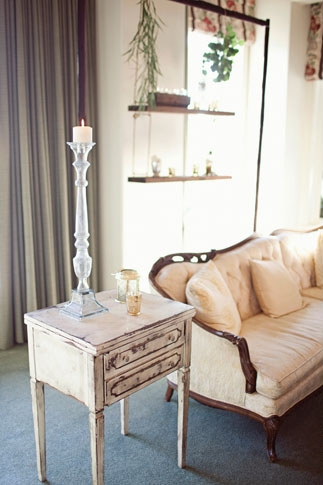 Vintage table with candle stick - Picture by Joielala