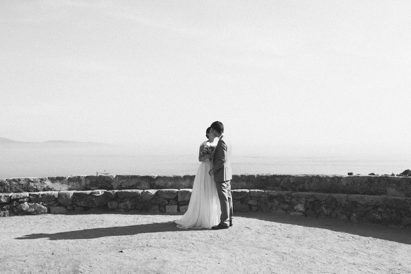 Bride and groom hugging in front of Corsica coast line - Picture by DanielRM